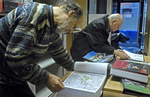 .: Julian Cheyne looking at a volume of plans in the Stratford cubicle. © martin slavin